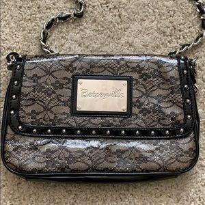 Betseyville black chain crossbody bag.